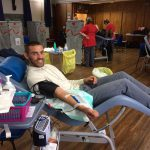 Captain Shaun Pearson giving blood at the Parish Hall in Chirk